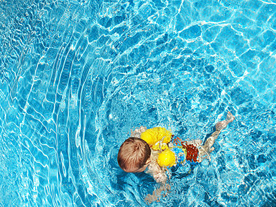 Young Boy Swimming in Pool - p6945014 by Noll Images