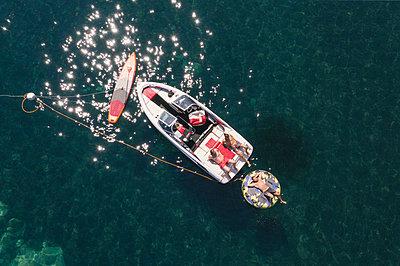 Sunbathing on the motor boat - p1437m2283304 by Achim Bunz