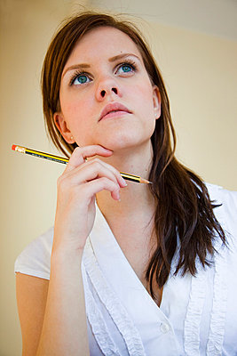 Woman with pencil - p4130422 by Tuomas Marttila