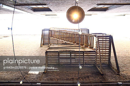 Fire escape on a building, worm's eye view - p1643m2229376 by janice mersiovsky