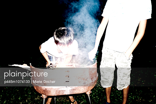 Friends playing with fire - p445m1074133 by Marie Docher