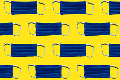 Pattern of blue protective face masks against yellow background - p300m2198251 by Gemma Ferrando