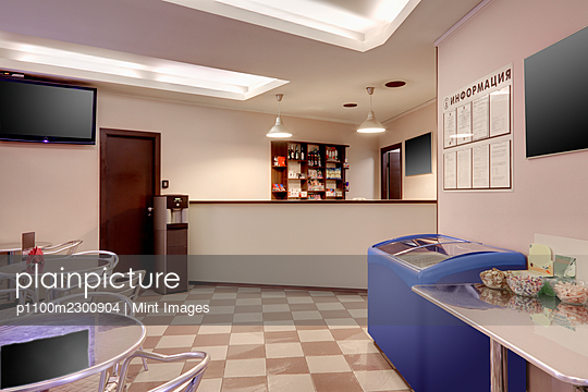 Lounge at reception in an auto repair shop business - p1100m2300904 by Mint Images