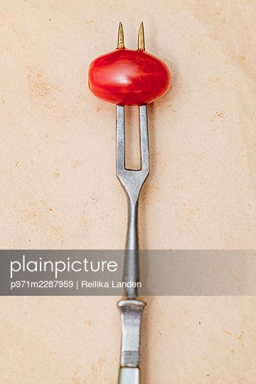 Pierced cherry tomato - p971m2287959 by Reilika Landen