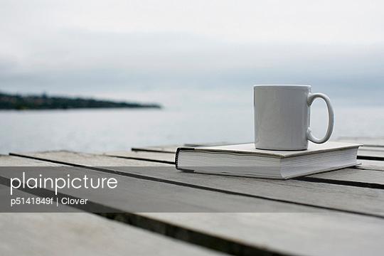 Mug and book on deck