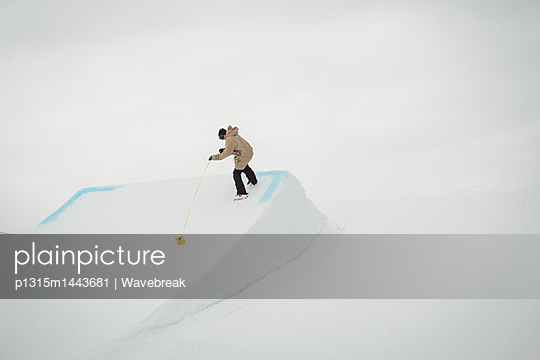 Man cleaning snow in ski resort