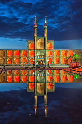 Amir Chaqmaq complex facade illuminated at sunrise and reflecting in a pond, Yazd, Yazd province, Iran, Middle East - p871m2209236 by G&M Therin-Weise