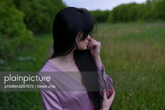 Woman wearing purple dress - p1646m2257573 by Slava Chistyakov