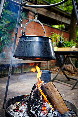 Cooking Pot Hanging On Hook Over Bonfire - p1026m857183f by Dario Secen
