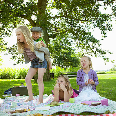 Children playing at picnic - p42916712f by Henrik Weis