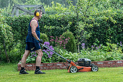Mowing the lawn - p1241m1481470 by Topi Ylä-Mononen