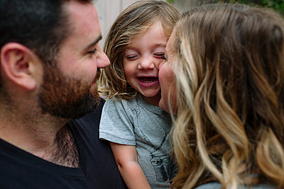 Close-up of happy family at backyard - p1166m1530743 by Cavan Images