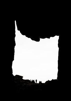 Silhouettew in Torghatten, Norway - p1682m2264042 by Régine Heintz