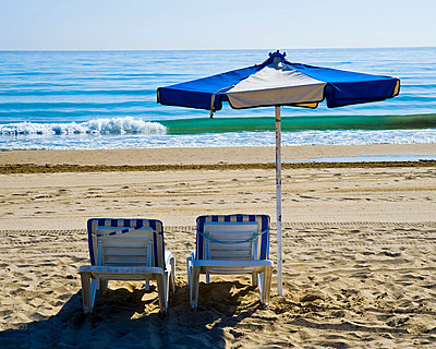 Sunlounger and parasol on beach, Benidorm, Costa Blanca, Spain - p9242066f by Image Source