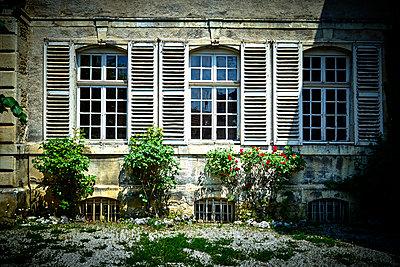 Lattice windows at old manor house - p1312m2150473 by Axel Killian