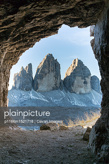 Mountains seen through cave - p1166m1521718 by Cavan Images