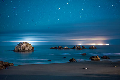 Scenic view of seascape against sky at night - p1166m1523220 by Cavan Images