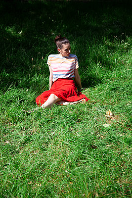 Woman relaxing in grass - p1248m2200417 by miguel sobreira