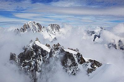 peaks of a snowy mountain range - p44213024f by Arlene Bax