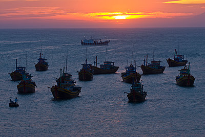 Fishing boats at sunset in habour in the port Mui Ne, Vietnam, Indochina, Southeast Asia, Asia - p871m1073144f by Michael Runkel