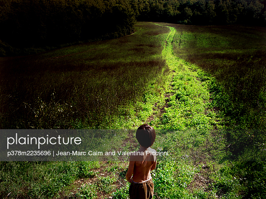 Young boy on rural path - p378m2235696 by Jean-Marc Caim and Valentina Piccinni
