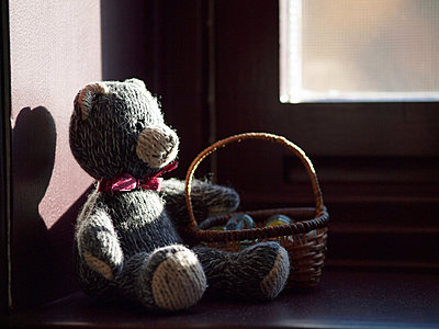 Child's teddy bear sitting by window - p1072m828926 by Clive Branson