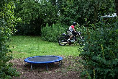 Motorbiker and a trampoline - p906m1362775 by Wassily Zittel