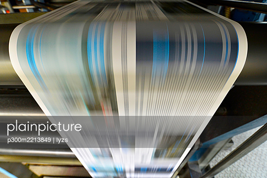 Printing of newspapers in a printing shop - p300m2213849 by lyzs