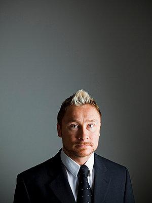 Portrait on businessman - p4266824f by Tuomas Marttila