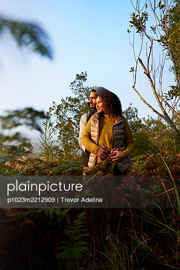 Serene young couple hugging in nature - p1023m2212909 by Trevor Adeline