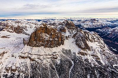 Aerial view of Tofane in winter, Ampezzo Dolomites, Veneto, Italy - p1166m2104682 by Cavan Images