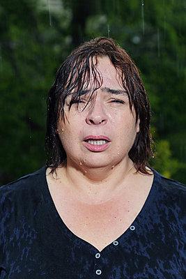 Close-up of a big woman with a wet face - p1540m2100914 by Marie Tercafs