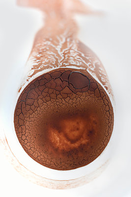 Cocoa mug sediment abstract - p1048m1519286 by Mark Wagner