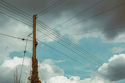 Complicated telephone pole and cables - p1228m1123772 by Benjamin Harte