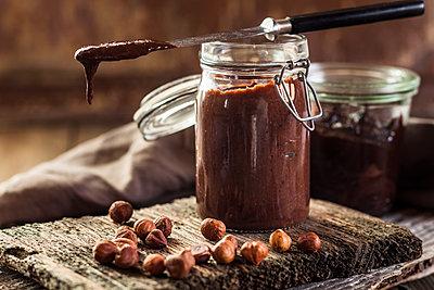 Glass of homemade chocolate spread - p300m2005390 by Susan Brooks-Dammann