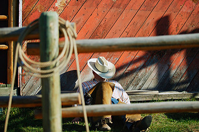 Cowboy takes a nap - p4420290f by Design Pics