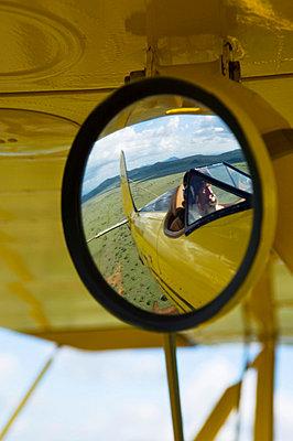 Will Craig flies his 1930s style Waco Classic open cockpit bi-plane as the ultimate aerial safari - p6521155 by John Warburton-Lee