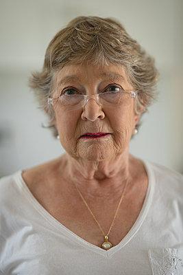 Senior woman looking at camera - p1315m1514698 by Wavebreak