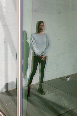 Reflection, Young woman - p975m2245769 by Hayden Verry