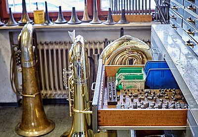 Workshop of an instrument maker with brass instruments - p300m1157020 by Dirk Kittelberger