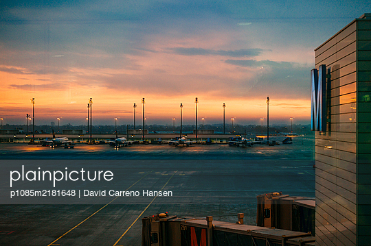 Airport at dawn - p1085m2181648 by David Carreno Hansen