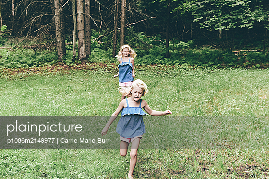 Two girls in the forest - p1086m2149977 by Carrie Marie Burr