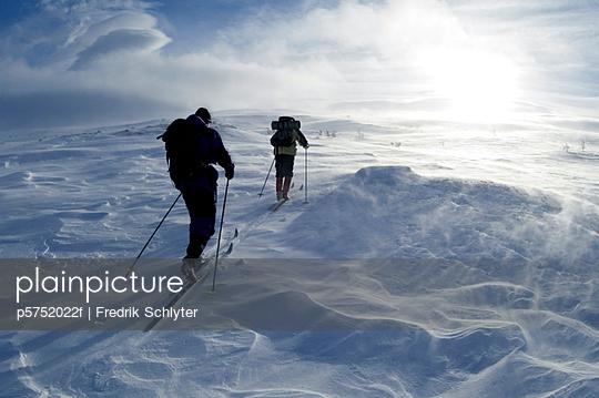 Skiers in snowy weather Harjedalen Sweden