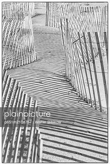 USA, New England, Massachusetts, Nantucket Island, Madaket, Madaket Beach, sand fence and shadows - p651m2104757 by Walter Bibikow