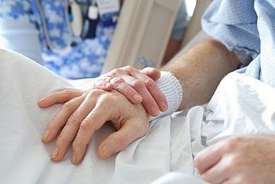 Nurse's Hands Comforting Patient - p1490m1578267 by Michael Malyszko
