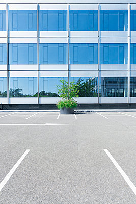 Parking lot in front of an office building - p300m1069109f by visual2020vision
