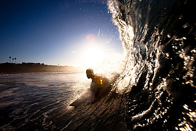 A male surfer pulls into a barrel at Zuma beach in Malibu, California - p3436932f by Kyle Sparks