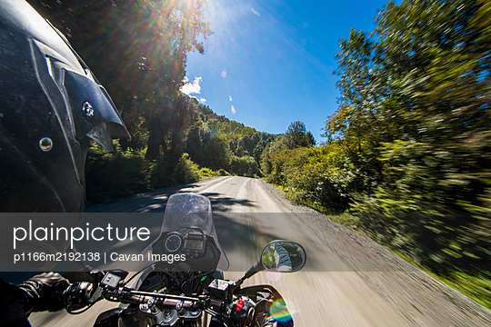Man driving on a touring motorbike on Ruta 7 - the Carretera Austral - p1166m2192138 by Cavan Images