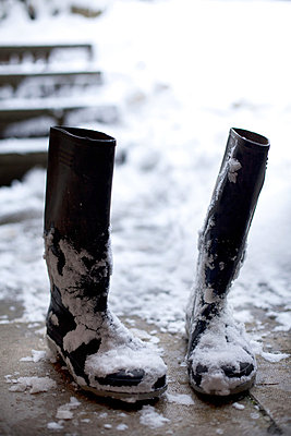 Pair of wellington boots in snow - p9240712 by Julian Ward