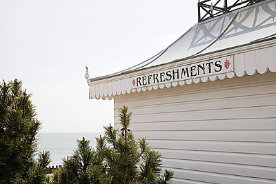 Beach hut cafe - p9242477f by Image Source